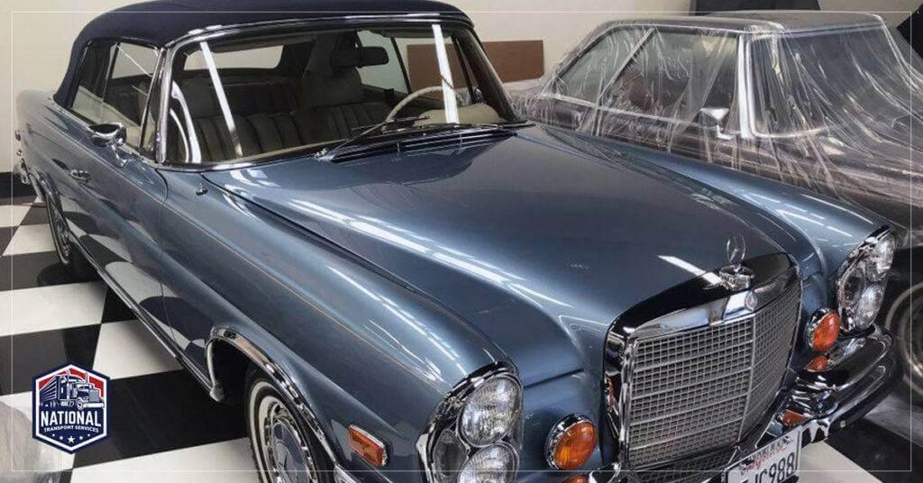 Transporter Silver Blue w111 mercedes benz convertible on showroom floor